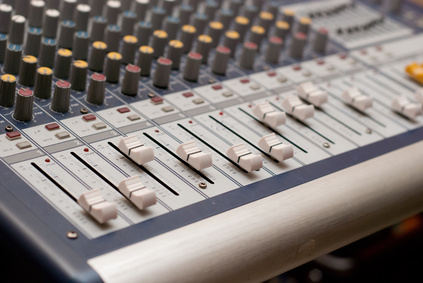 Volume faders on a mixing desk