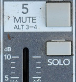 The mute and solo buttons just above the channel's volume fader
