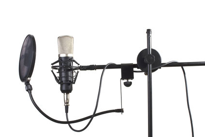A shock mount and a pop filter are very useful in the studio
