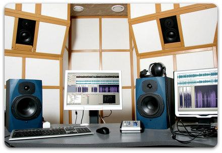 Far-field monitors can be seen placed inside the walls, and near-field monitors can be seen on the desk